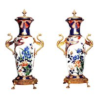 pair of antique French vases in richly decorated porcelain from the early 1900s
