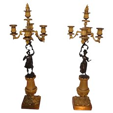 Pair of beautiful candelabra with bronze sculptures in the French Empire style 1800
