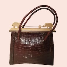1930S  Art deco juvenile crocodile handbag with Bakelite elephants top