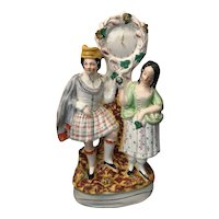 19th Century Staffordshire Flatback Figure of Scottish Couple with Clock Face
