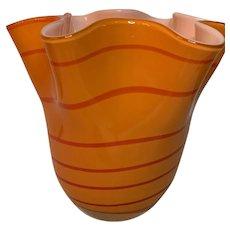 Vintage Fluted orange art glass vase with dark orange swirls solid white interior