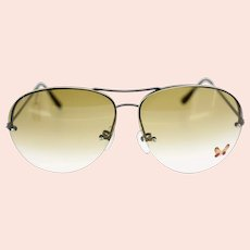 Vintage ladies pilot-style sunglasses with a butterfly motif