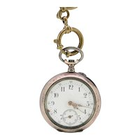 Ancre 800 silver cased antique pocket watch with brass chain (Weight: 34.2g / Chain weight: 16.2g)