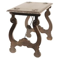Spanish baroque style side table, with lyre legs.