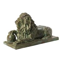 Reclining lion with paw on orb - Bronze - France, early 20th century