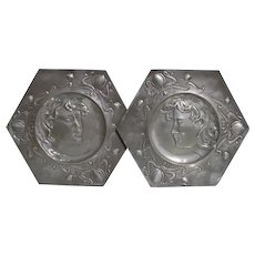 Art Nouveau pair of pewter handcrafted floral wall plaques.