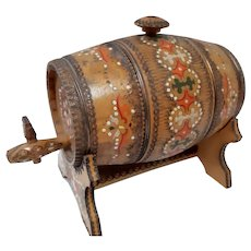 Vintage wooden pyrography and hand painted cask on a stand