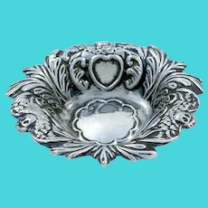 Miniature Victorian sterling silver Cupid pin / ring dish