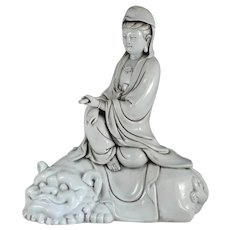 Stunning antique Chinese Dehua porcelain Blanc-de-Chine seated Guanyin on Buddhistic Lion