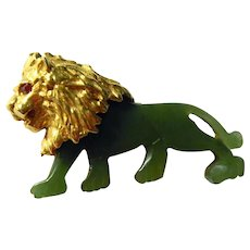 Signed Swoboda Jade Lion Pin with Ruby Chip Eyes.
