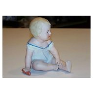 """Germany Reichmannsdorf Porcelain Co. Vintage 1900's """"Sitting Piano Baby"""" 4-1/2"""" Tall"""