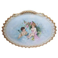 """Gorgeous 13-3/4"""" Limoges France 1904 Hand Painted """"Cherub Playing His Flute to A Little Girl"""" Scenic Plaque by the Artist, """"T. Lay"""""""