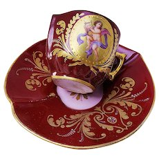 "Outstanding Royal Vienna 1900's Double Portrait Deep Red Hand Painted ""Putti Playing Hand Harp & Putti Blowing Horn"" Scenic Heart Shape Cup & Saucer"