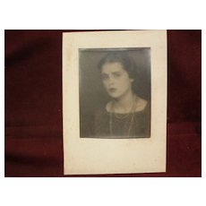 MAN RAY (1890-1876) pencil signed vintage photograph of a young woman in Paris circa 1925