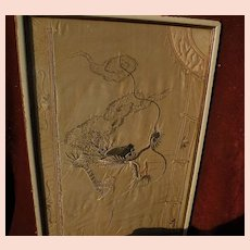 Old Chinese textile silk decorated jacket framed as a fragment