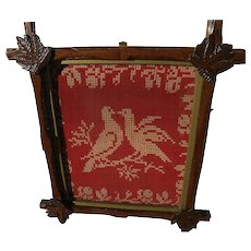 Antique American folk art needlework of two birds