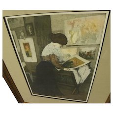 MANUEL ROBBE (1872-1936) important French printmaker color aquatint of lady examining prints in the studio