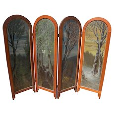 Circa 1900 American four panel room divider with painted panels of Four Seasons