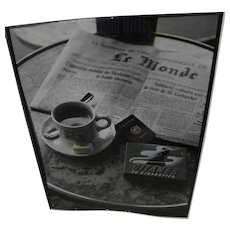 Arty signed black and white photograph of Paris cafe tabletop with newspaper and coffee cup and cigarettes