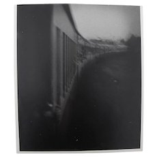 Vintage black and white photo of 1940's style moving train