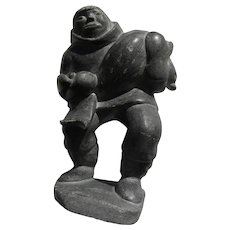 Canadian art Inuit soapstone carving of native hunter with seal, includes official label