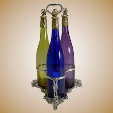 Three Victorian Coloured Glass Decanters In Stand c.1890