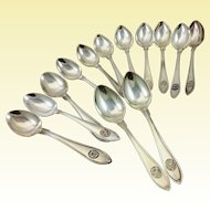 Set of 13 Swedish 830 silver spoons with crests