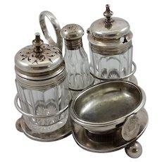 Four-piece silver cruet set with royal family crest c. 1893