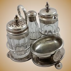Four-piece silver cruet set with royal family crest c. 1893