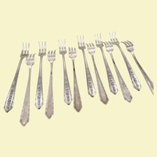 Set of 12 seafood sterling forks by Wallace