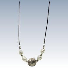 Small leather Necklace with 4   Fresh-water  Baroque Pearls and Silver Center