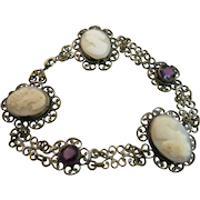 VINTAGE Filigree Bracelet of a yellow tone metal with 3 shell Cameos  Very Old