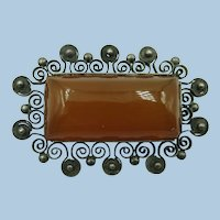 VINTAGE    Older Brooch with Interesting Character Carnelian Colored Set Darker Metal
