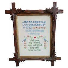 VINTAGE   Walnut Carved Leaf  Frame with Cross-Stitch Sampler