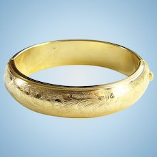 Vintage Classic Goldtone Repousse Oval Hinged Bangle Bracelet Floral and Scrollwork