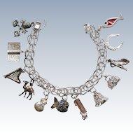 Vintage Sterling Silver Charm Bracelet With Twelve Charms