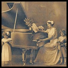 Sepia Postcard Mother With Children Grand Piano