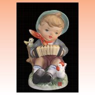 Vintage Lipper & Mann Boy with Birds Playing Squeezebox Figurine