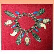 Selro Selini Devil Face Charm Bracelet Signed  15 Charms  C 1950's