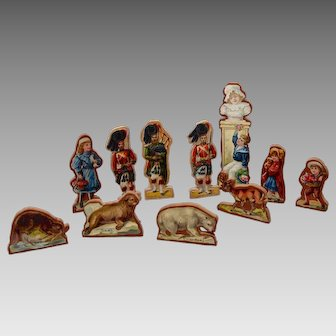 11 Lithograph Paper and Wood Stand-Up Toys Circa 1890
