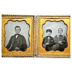 Ambrotype of Family, Father, Mother and Son holding Photographic Cases