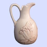 Red Wing Embossed Magnolia Pottery Pitcher