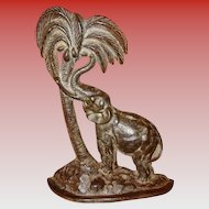 Neat vintage cast iron doorstop-Elephant palm tree coconut