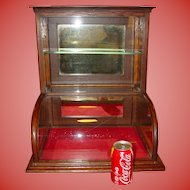 Small quartered oak curved glass tower display case cabinet