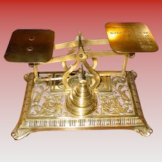 Brass letter postal scale with Griffins and weights