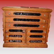Fine antique 9 drawer Chadwick's spool thread cabinet