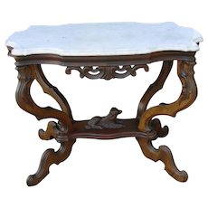 Victorian Walnut turtle top marble top table w carved dog stretcher