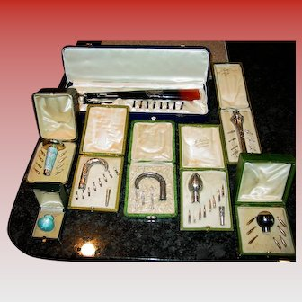 8 antique Parasol handles all in their original fitted box