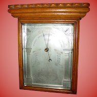 Very unusual oak cased aneroid wall barometer--19th century