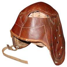 antique Princeton style leather football helmet